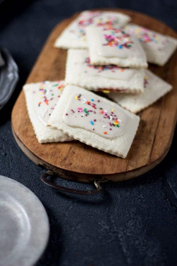 Gluten Free Frosted Strawberry Pop-Tarts Toaster Pastries recipe by @gfshoestring on @beardandbonnet www.thismessisours.com