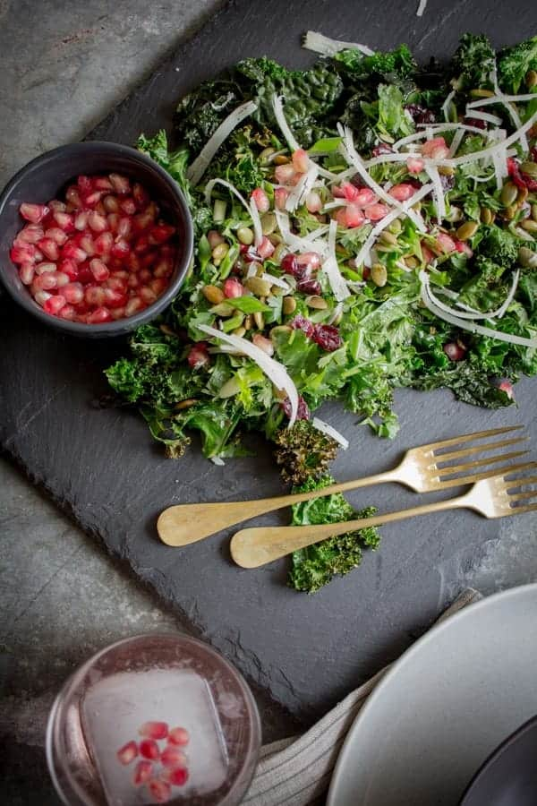 Crispy Kale Salad with Pomegranate and Pepitas recipe by @beardandbonnet on www.thismessisours.com