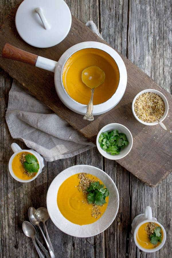 Creamy Roasted Carrot Soup with Citrus & Dukkah recipe by @beardandbonnet on www.thismessisours.com