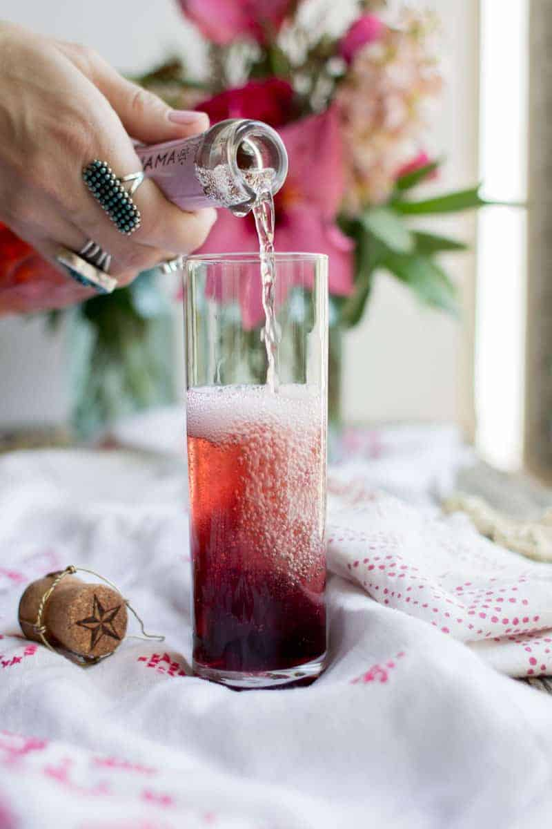 Hibiscus Rosé Mimosa recipe by @beardandbonnet on www.thismessisours.com