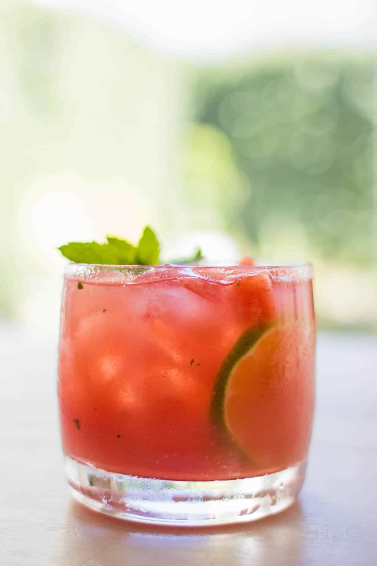 It takes less than 5 minutes to shake up a few of these Easy Melon Mojitos and they are the perfect way to #DrinkTheSummer Recipe on @beardandbonnet