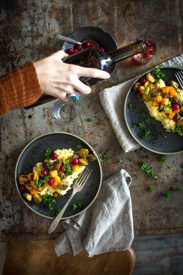 Roasted Brussels and Squash over Creamy Garlic Polenta. The perfect veg friendly main for Thanksgiving! | Vegan & Gluten Free | on @beardandbonnet