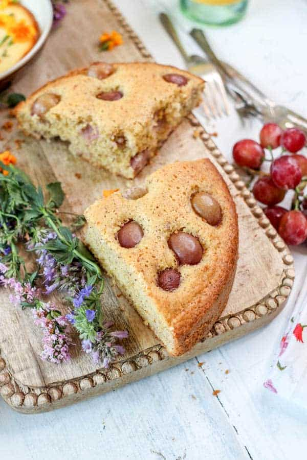 wedges of Olive Oil Cake with Polenta and Roasted Red Grapes