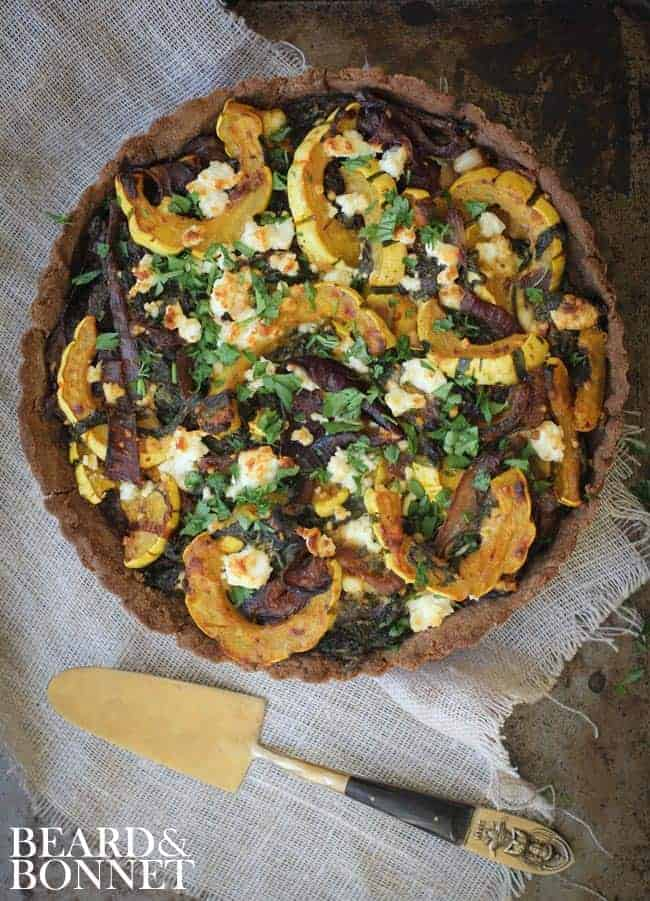 Mixed Baby Greens, Delicata Squash, Caramelized Onions and Feta Tart