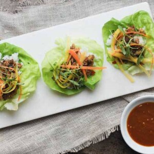 lettuce wraps with sushi rice, vegetarian mushroom, water chestnut, and walnut filling with shredded carrots, micro greens and homemade hoisin sauce