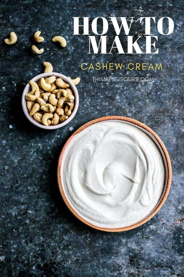 "A bowl of silky cashew cream sauce next to a smaller bowl of raw cashews on a metal surface. the words ""How to make cashew cream"" are on the image."
