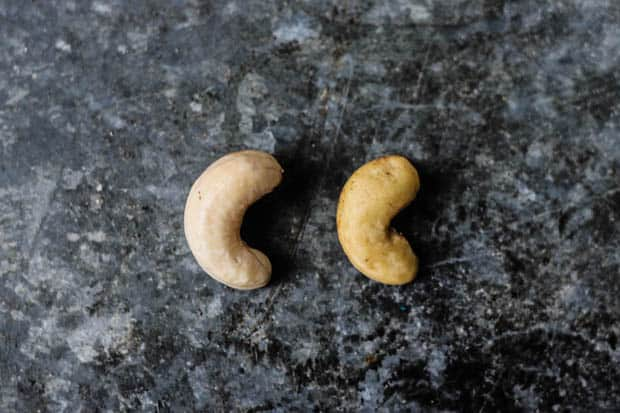 A raw cashew and a raw cashew that has been soaked in filtered water overnight next to each other to show size difference.