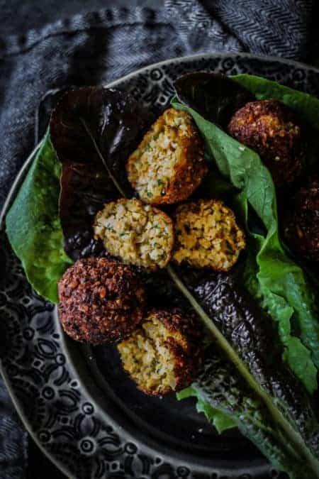 Sweet Potato & Millet Falafel split open over red and green leaf lettuce