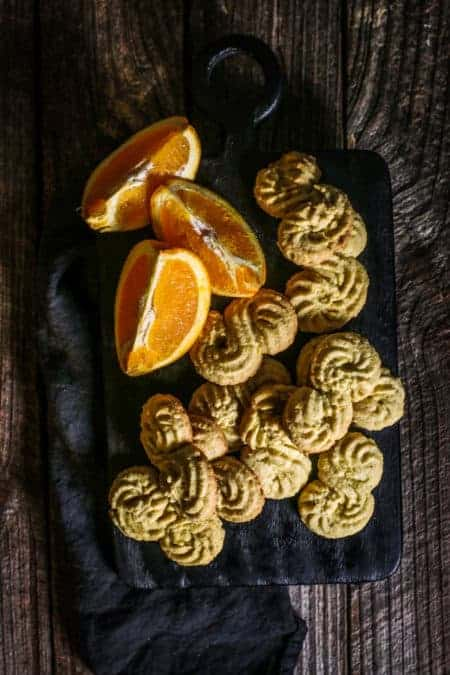 Gluten Free Italian Polenta Cookies on a serving board with wedges of citrus.