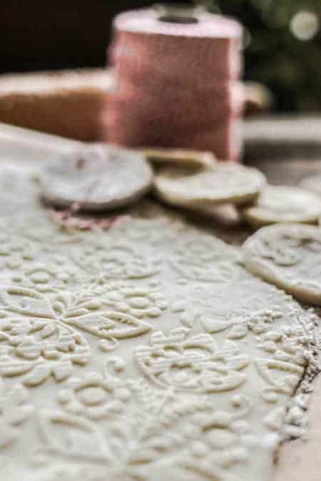 An up close image of a slab of salt dough with a pattern imprinted on it