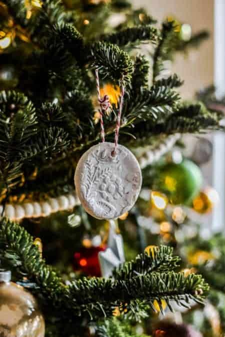 A salt dough ornament on a decorated tree