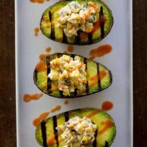 Vegan Mexican Street Corn in Grilled Avocado Boats recipe by @beardandbonnet www.beardandbonnet.com