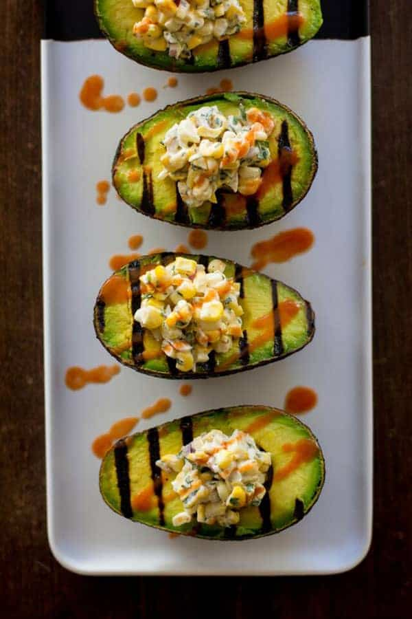 Vegan Mexican Street Corn in Grilled Avocado Boats recipe by @beardandbonnet www.beardandbonnet.com