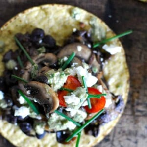 Mixed Mushroom Tostadas with Charred Scallion Pesto and Black Beans recipe by @holajalepeno on www.beardandbonnet.com