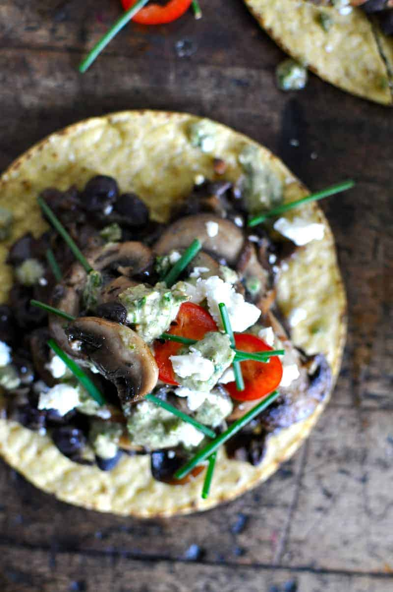 Mixed Mushroom Tostadas with Charred Scallion Pesto and Black Beans recipe by @holajalepeno on www.thismessisours.com