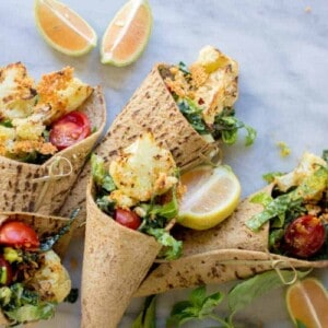 Crispy Cauliflower Caesar Wraps with @flatoutbread by @beardandbonnet on www.thismessisours.com