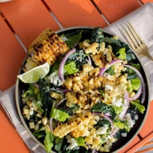 grilled corn salad with red onions, greens, and Cotija cheese