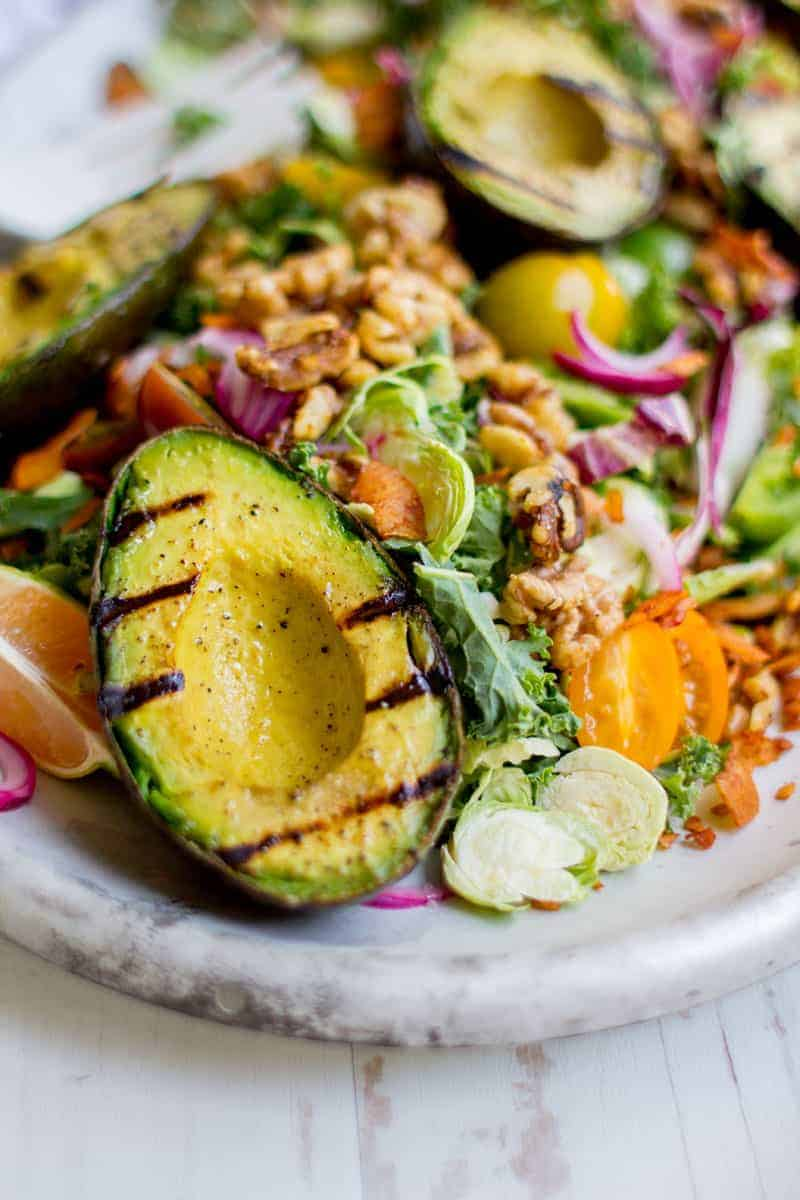 a grilled avocado on a salad