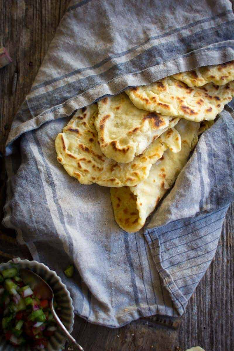 Gluten Free Roasted Garlic Naan in a basket lined with a linen