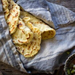 Gluten Free Roasted Garlic Naan wrapped in a towel to keep warm