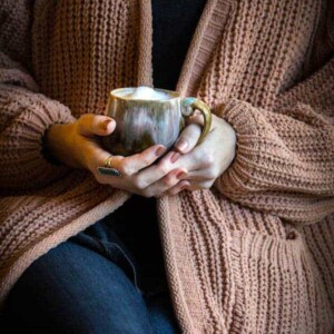 5 Easy Ways To Practice Hygee In Your Home || @thismessisours || Wrap yourself in cozy sweaters and blankets