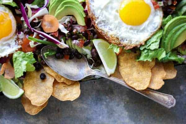 Huevos Rancheros Breakfast Salad recipe || Crisp frizzled eggs with runny yolks mix with the spicy tart juices from homemade pico creating one heck of a dressing for this Easter brunch worthy breakfast salad! || @thismessisours @yourtaylorfarms #vegetarian #glutenfree #Easter