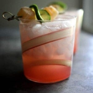 A Rhubarb Ginger Beer Margarita with a fresh rhubarb swirl garnish in the glass