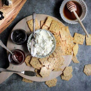 Red, White, & Blue Dunk and Slather Board recipe    Decadent homemade ricotta pairs perfectly with homemade jam flavors like blueberry lavender and strawberry rose. They make for the perfect snack platter when paired with @crunchmaster crackers.    @thismessisours #glutenfree #vegetarian #spon