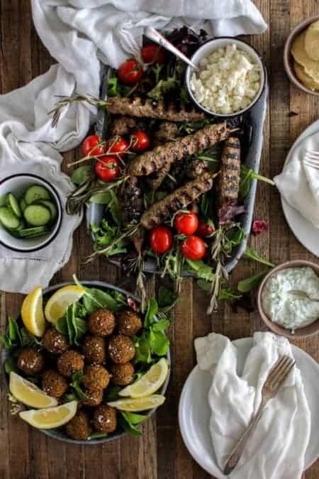 lamb kofta on rosemary skewers, falafel, tzatziki, cucumber slices, feta