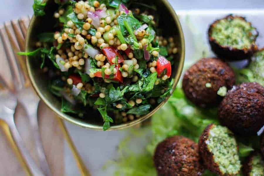Sorghum Tabbouleh made with sorghum, tomatoes, parsley, and onions served with falafel