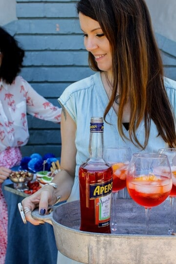 Strawberry Aperol Spritz Poptails recipe || Turn that spritz break into a popsicle break with these festive poptails! || @thismessisours #FriendsWhoFete