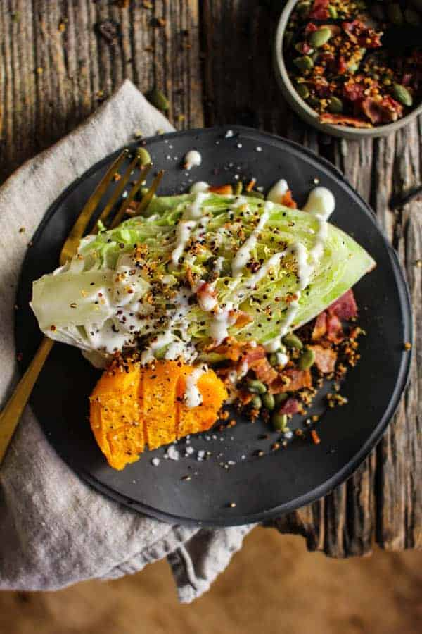Roasted Butternut and Ranch Autumn Wedge Salad recipe || Butternut squash truly shines in this ranch smothered wedges salad with garlic laced crispy quinoa and smoky bacon. || @thismessisours @litehousefoods #spon