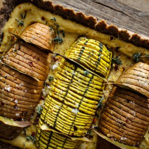 Vegan Hasselback Thanksgiving Tart recipe || this #vegan tart is sure to impress your friends and family this holiday season. Whether you serve it as a plant based main dish or a decadent side to your traditional turkey and mash, this one is sure to turn some heads! || @thismessisours #vegan #glutenfree #thanksgiving
