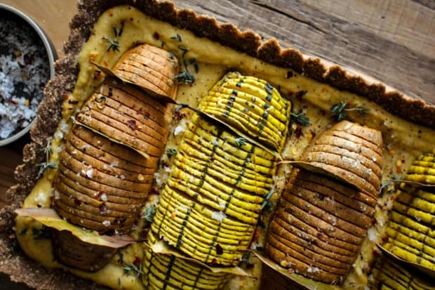 Vegan Hasselback Thanksgiving Tart recipe    this #vegan tart is sure to impress your friends and family this holiday season. Whether you serve it as a plant based main dish or a decadent side to your traditional turkey and mash, this one is sure to turn some heads!    @thismessisours #vegan #glutenfree #thanksgiving