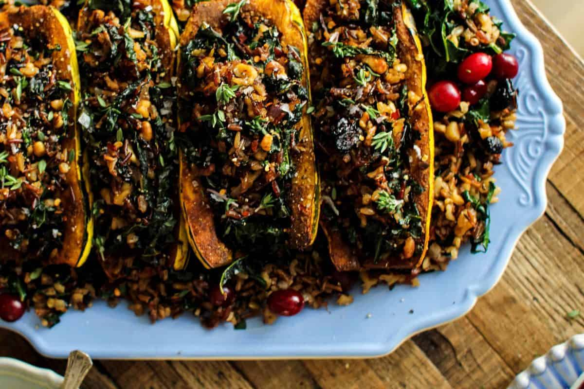 Exotic Rice Stuffed Delicata Squash with Curried Cashew Cream recipe    These curry spiced delicata squash are filled to the brim with an exotic rice blend loaded with onion, garlic, walnuts, kale, and dried bing cherries. This dish is the perfect plant based main dish for your holiday table!    @thismessisours @nutsdotcom