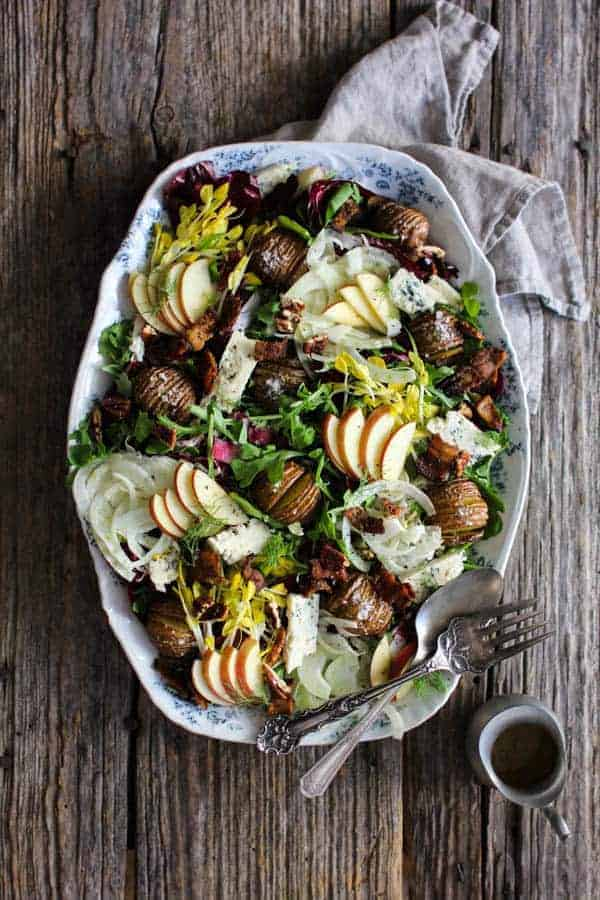 Orchard Inspired Holiday Salad recipe || I love all of the flavors of fall, but apple just happens to be my all-time favorite. This salad is brimming with apple goodness and all of the flavors that pair so well with it like Simply Artisan Reserve Gorgonzola Center Cut Cheese, crispy bacon, thinly shaved fennel, candied pecans, and bitter greens all slathered in a delicious apple cider dressing! || @thismessisours @litehousefoods #centerofattention #simplyartisanreserve #litehousefoods #ad