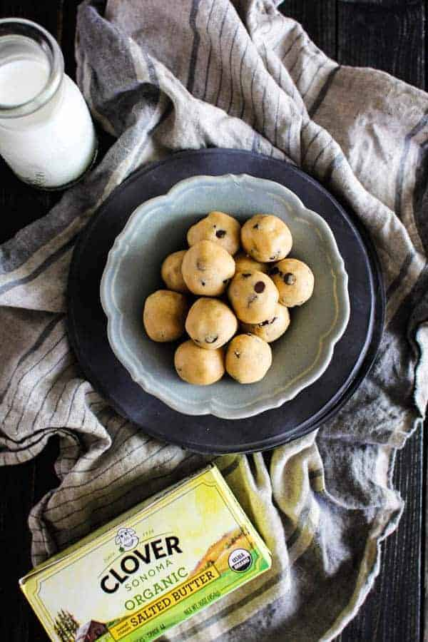 Peanut Butter Chocolate Chip Cookie Dough Bites recipe    Who doesn't love cookie dough?! Honestly, I think we like the dough more than the actual cookies which is why we created this egg free, no bake recipe that makes indulging in the best part of the cookie making process worry free!    @thismessisours #ad @cloversonoma #glutenfree #vegetarian #CheersToTraditions