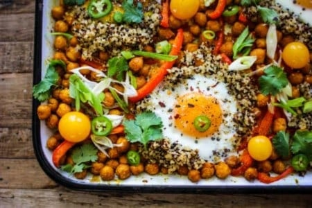 sheet pan with chickpeas, bell peppers, quinoa, eggs, cherry tomato, green onion