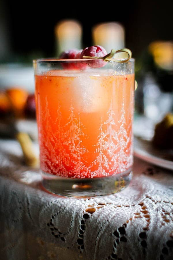 Cranberry Sauce Dark & Stormy recipe || Quite possibly the tastiest way to use up all of that cranberry sauce during the holidays! || @thismessisours #FriendsWhoFete #vegan