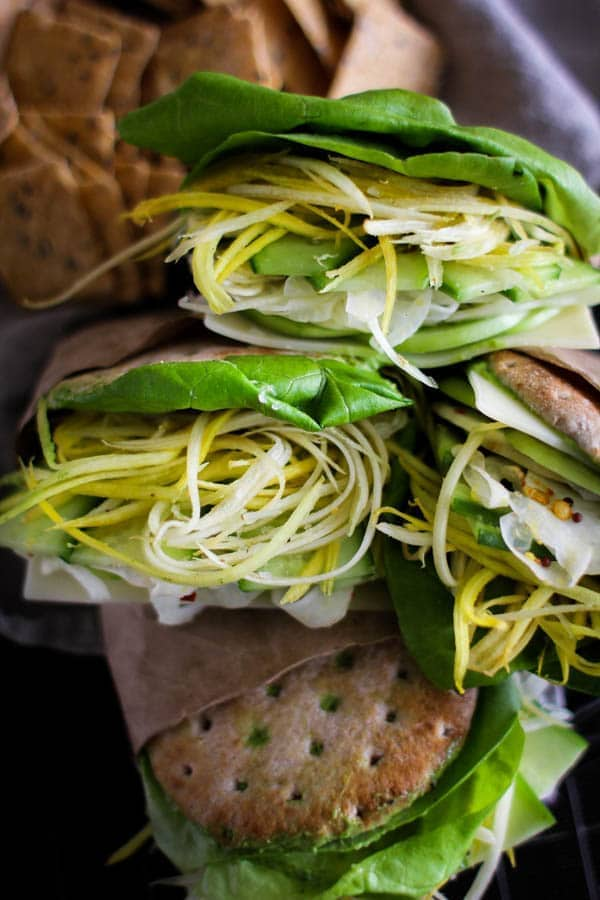 sandwiches with green goddess spread , butter lettuce, shredded carrots, pickled fennell