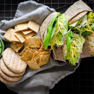 tray of green goddess sandwiches with crackers, sandwich spread, pickled fennel