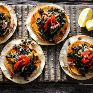 baked tostada with black-eyed pea hummus, roasted sweet potato, and jammy collard greens