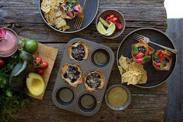 crispy black bean taco cup in muffin pans with toppings