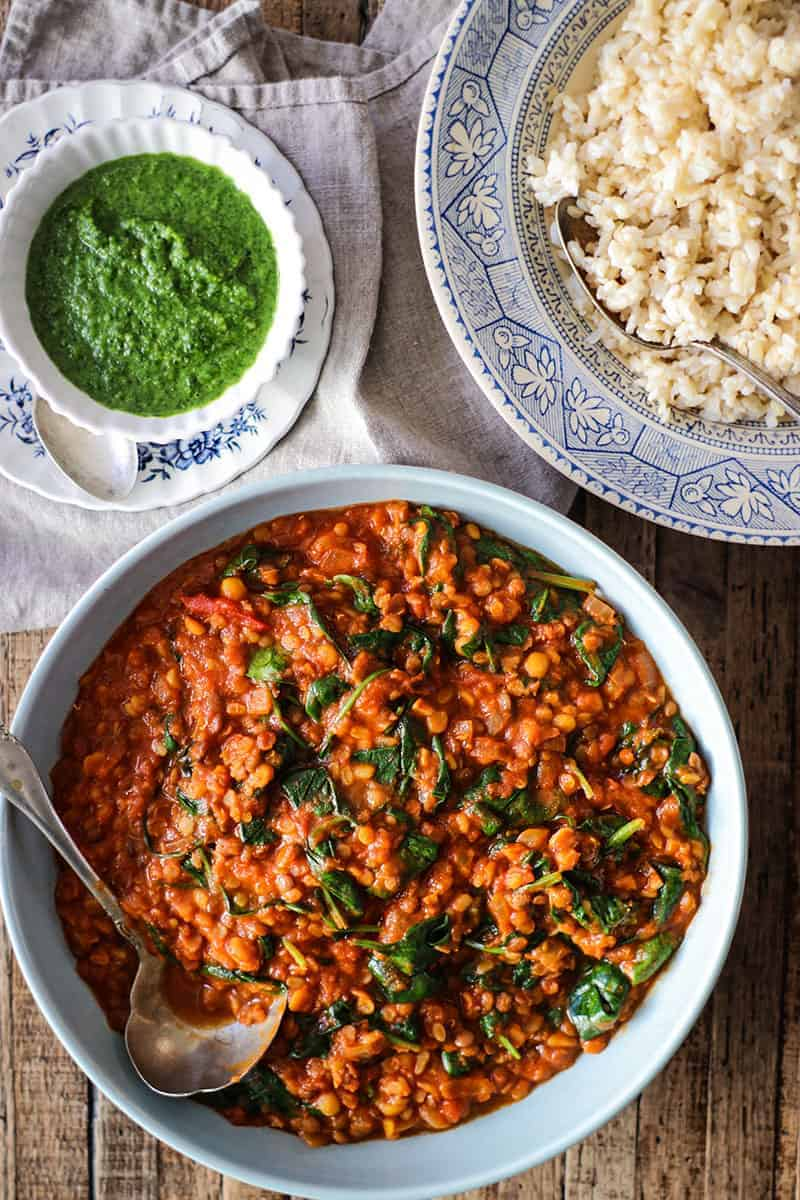 Bowls of curry, brown rice, and cilantro chutney