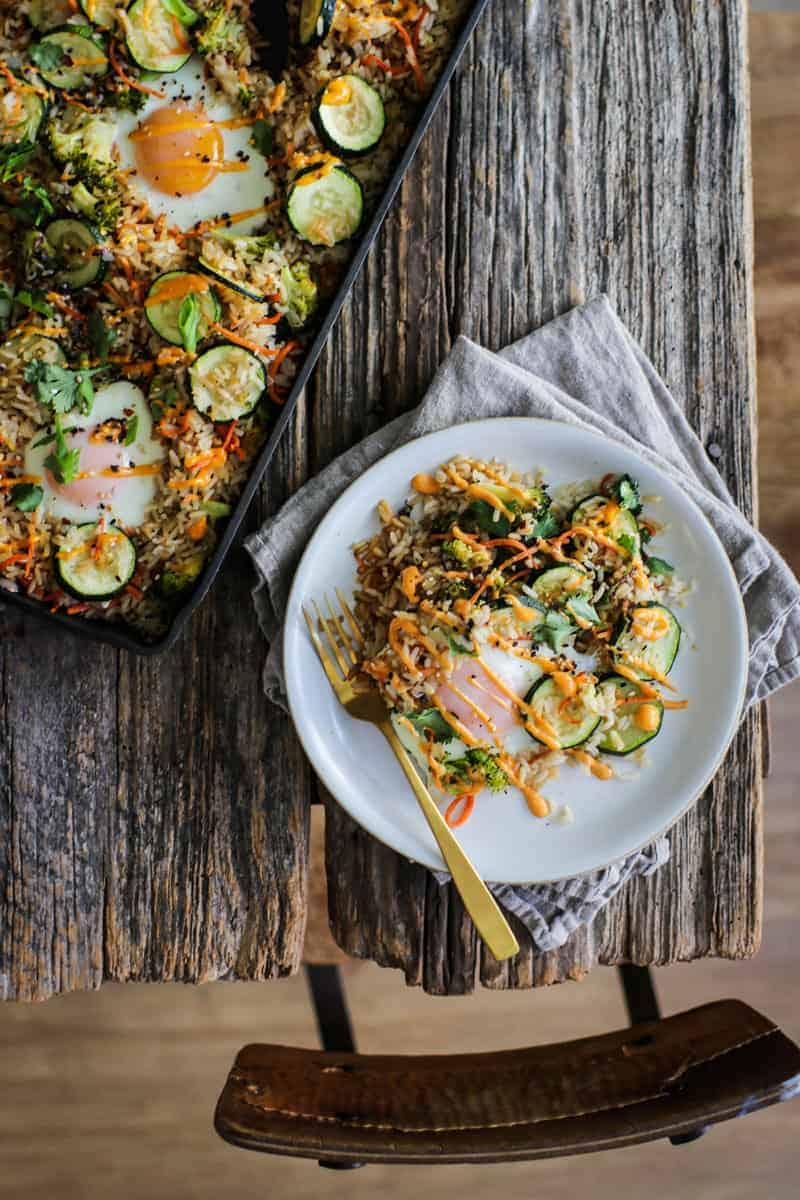 A pan of sheet pan fried rice and a plate served with sheet pan fried rice