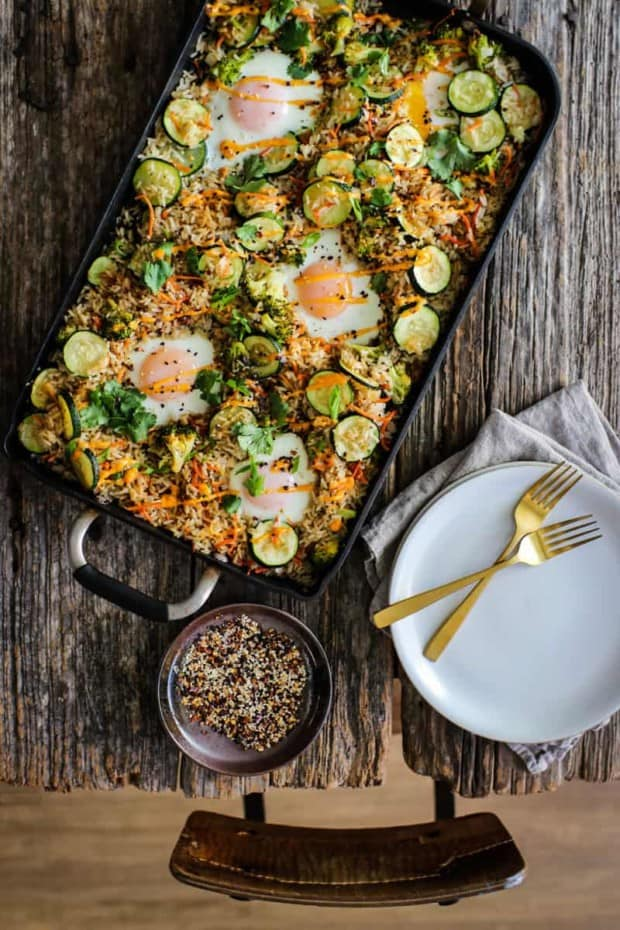 sheet pan fried rice on table with spices and plates