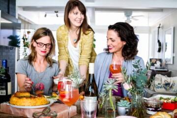 Aida Mollenkamp, Kate Ramos, and Meg van der Kruik sitting at the brunch table.