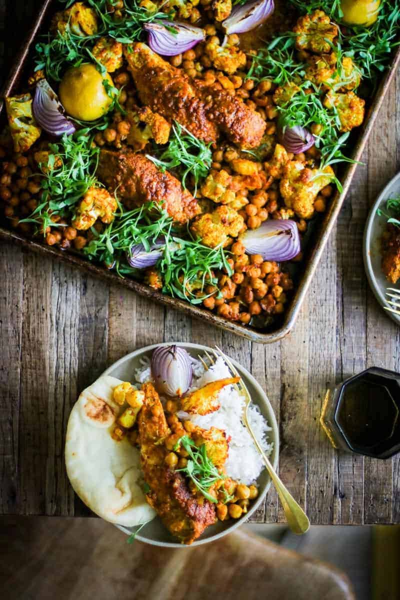 Shawarma Spiced Chicken Sheet Pan Dinner with chicken, cauliflower, chickpeas, red onion, lemon and cilantro