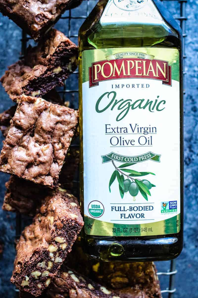 Bottle of Pompeian Organic Extra Virgin Olive Oil and squares of brownies