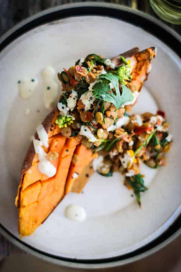 Roasted sweet potato smothered in Moroccan spiced lentils then drizzled with tahini dressing